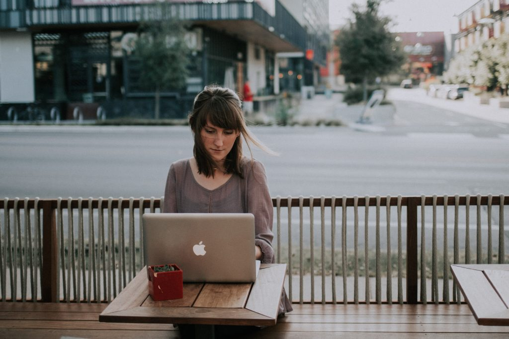 Woman working outside with laptop